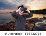 the man with glasses of virtual ... | Shutterstock . vector #593432798