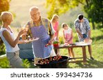 happy family having a barbecue... | Shutterstock . vector #593434736