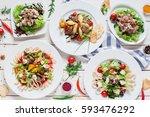 warm salads assortment on... | Shutterstock . vector #593476292