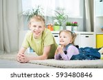 sister and brother playing... | Shutterstock . vector #593480846