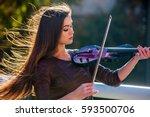 busker woman perform music on... | Shutterstock . vector #593500706
