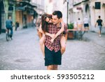 young man giving girlfriend... | Shutterstock . vector #593505212