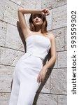 beautiful sexy woman blond hair ... | Shutterstock . vector #593559302