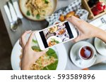 woman taking photo on cellphone ... | Shutterstock . vector #593589896