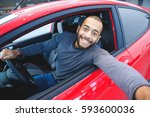 first car pic. handsome young... | Shutterstock . vector #593600036