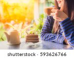 woman relaxing and drinking... | Shutterstock . vector #593626766