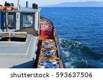 a boat carries boxes with fresh ... | Shutterstock . vector #593637506