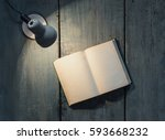 lamp and opened book on wooden... | Shutterstock . vector #593668232