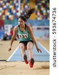 Small photo of ISTANBUL, TURKEY - DECEMBER 18, 2016: Athlete Eda Yilmaz Long Jumping during Turkish Athletic Federation Olympic Threshold Indoor Competitions