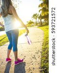 female jogger in a city park... | Shutterstock . vector #593721572