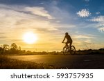 Silhouette Of A Woman Rides A...