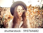 outdoor fashion photo of young... | Shutterstock . vector #593764682