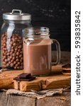 glass of chocolate milkshake... | Shutterstock . vector #593835842