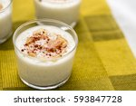 rice pudding with maple syrup   ... | Shutterstock . vector #593847728