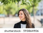cheerful businesswoman standing ... | Shutterstock . vector #593864906