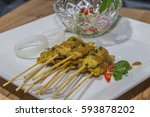 satay   chicken satay and with... | Shutterstock . vector #593878202