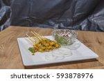 pork satay grilled pork served... | Shutterstock . vector #593878976