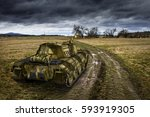 army tank on the muddy field... | Shutterstock . vector #593919305
