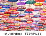 colorful umbrellas on the... | Shutterstock . vector #593954156