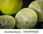 lobes of a lime with a mint... | Shutterstock . vector #593999585