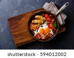 english breakfast in cooking... | Shutterstock . vector #594012002
