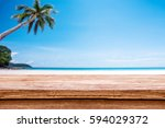 wood terrace over blue sea and... | Shutterstock . vector #594029372
