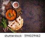 spicy chicken tikka masala in... | Shutterstock . vector #594029462