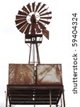 An Old Water Windmill  Rusted...