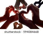 various hands forming a symbol... | Shutterstock . vector #594084668