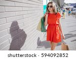 two beautiful young women walk... | Shutterstock . vector #594092852