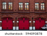 A Fire Station With A Wooden...