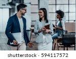sharing fresh office news. two... | Shutterstock . vector #594117572
