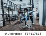 office fun. four young cheerful ... | Shutterstock . vector #594117815