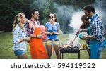 friends having fun grilling... | Shutterstock . vector #594119522