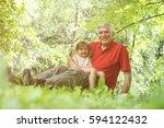grandfather hugging... | Shutterstock . vector #594122432
