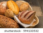 fresh fragrant bread on a dark... | Shutterstock . vector #594133532