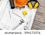 construction plans with helmet... | Shutterstock . vector #594172376