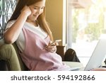 beautiful teenage woman use... | Shutterstock . vector #594192866