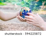 holding earth planet in the... | Shutterstock . vector #594225872