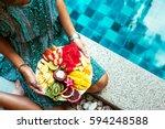 girl relaxing and eating fruit...   Shutterstock . vector #594248588