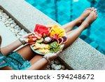 girl relaxing and eating fruit... | Shutterstock . vector #594248672