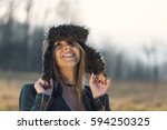 happy young woman with hat in... | Shutterstock . vector #594250325