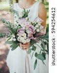 bride in light white dress... | Shutterstock . vector #594254612