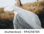 bride in wedding dress goes on... | Shutterstock . vector #594258785