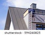 Roofer Assembles Sheet Metal O...