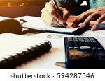 finance concept. man writing... | Shutterstock . vector #594287546