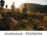 group of friends are hiking in... | Shutterstock . vector #594296546