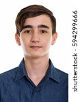 Small photo of Studio shot of face of young handsome Persian teenage boy isolated against white background isolated against white background
