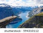 adventurous man at trolltunga.... | Shutterstock . vector #594310112