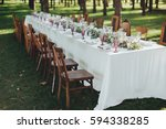 festive table served dishes and ... | Shutterstock . vector #594338285